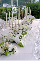White wedding arrangement with white flowers and candles.PNG