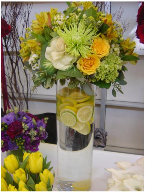 Yellow wedding flower arrangement with lemon png for Yellow flower arrangements centerpieces