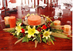 Orange candle centerpiece for wedding.PNG