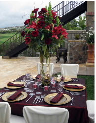 Picture of square table centerpiece wedding with red flowers.PNG