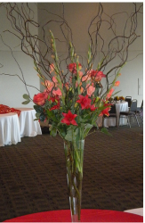 Picture of tall slime wedding centerpiece with flowers and branches.PNG