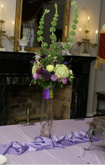picture of tall wedding centerpieces with purple and white