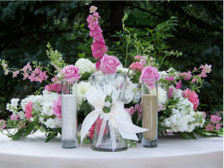 Reception table flower arrangement with white and pink flowers.PNG