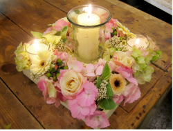 Square plate wedding center piece with candles and fresh flowers.PNG