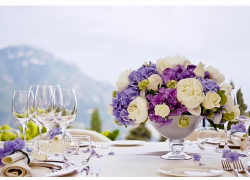 Summer wedding centerpiece with blue and purple flowers.PNG