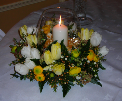 Table arrangement for wedding with yellow and white flowers.PNG