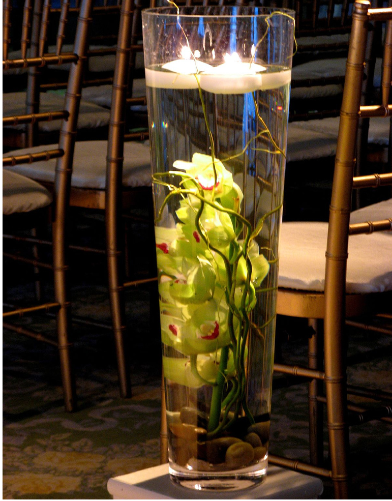 Tall glass wedding arrangement with green orchid flwoers.PNG