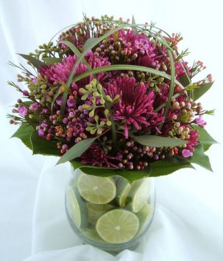 Chic wedding centerpiece pictures of pink purple flowers with limes in the vase.JPG
