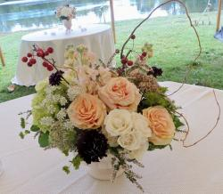 Summer wedding centerpiece with light color flowers with roses and other type of flowers.JPG