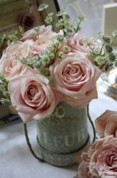 Vintage wedding center piece with pink roses.JPG