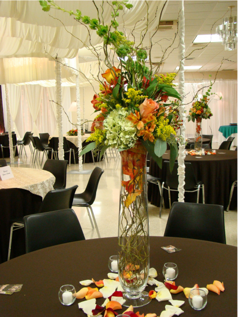 Tall wedding centerpieces with colorful flowers.