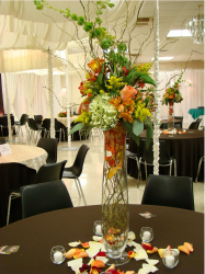 Tall wedding centerpieces with colorful flowers.PNG