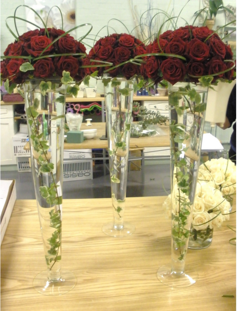 Wedding reception table arrangement with red roses png 1 for Center arrangements for weddings