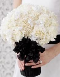 The Chanel Wedding bouquet pictures with beautiful white flowers with black.JPG