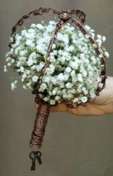 Unique wedding pictures with small flowers in white wrapped around by metal rings.JPG