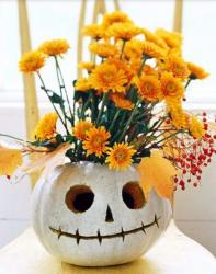 Pumpkin centerpiece with painted pumpkin with orange flowers.JPG