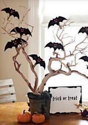 Cool Halloween decor with bats and pumpkins.JPG