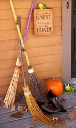 Halloween outdoor decoration ideas with witch theme brooms, witch shoes and pumpkin.JPG