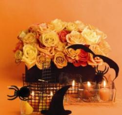 Halloween wedding centerpieces with orange and yellow roses and Halloween decoration with bats, spiders and witch hat.JPG
