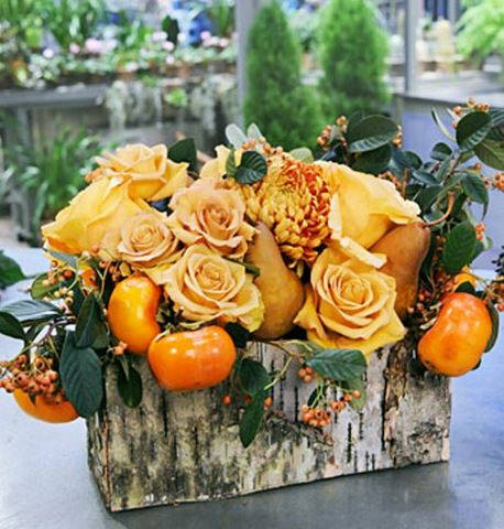 Natural 2015 Halloween centerpiece with fresh flowers and fresh fruits all in orange with wooden planter.JPG