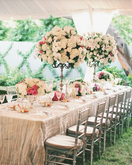 Fancy wedding reception ideas with tall large centerpieces and small centerpieces.JPG