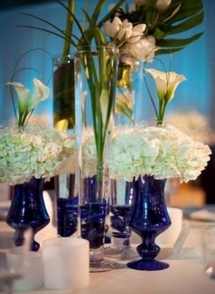 2015 wedding centerpieces with blue vases and white flowers.JPG