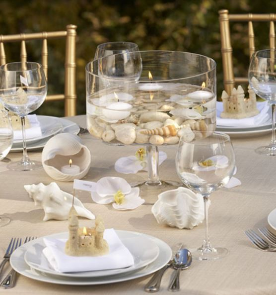Beach wedding centerpieces sea shells with candles.JPG