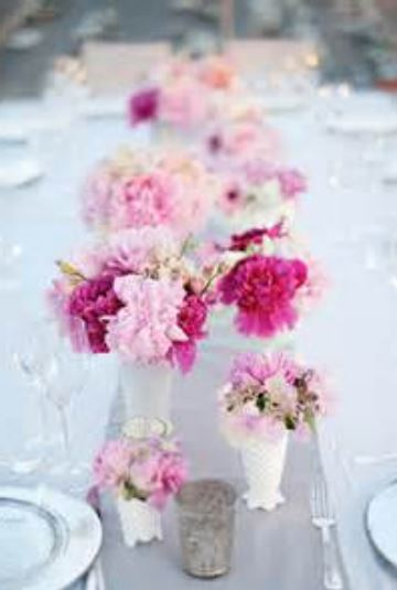 Beautiful summer wedding centerpieces with pink and hot pink flowers.JPG
