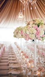 Classic wedding table centerpiece with white and pink flowers with white wooden flower stands.JPG