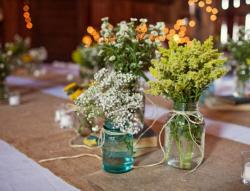 Cute and cheap wedding centerpieces with nutaral flowers with small white green flowers.JPG