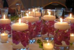 Elegant yet cheap wedding table deor ideas with flowers floating in the water and white candles.JPG