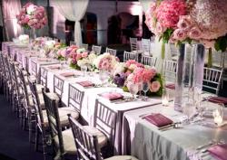 Expensive looking wedding table decoration with pink and purple flowers.JPG