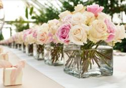 Simple cheap wedding reception table decoration with full of roses.JPG