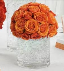 Simple wedding table decor ideas with large glass vases with orange roses.JPG