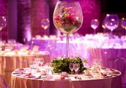 Large wine glass vase with flowers inside the vases.JPG