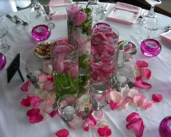 Pink flowers in vases perfect for wedding table decoration ideas photos.JPG