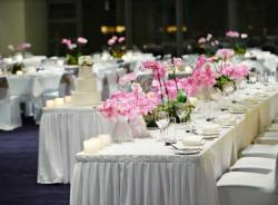 Wedding reception table cetnerpieces with pink flowers.JPG