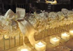 White flowers and white candles for wedding.JPG