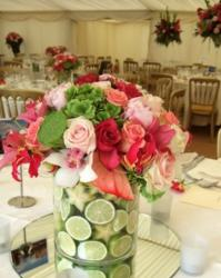 Summer wedding decoration ideas with pink flowers and lime in the vase.JPG