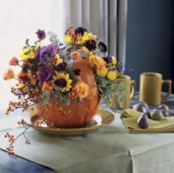 Pumpkin vase filled with fresh flowers.JPG