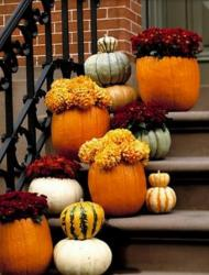 Front door halloween decoration with pumpkins.JPG