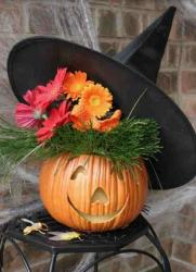 Halloween pumpkin decor with witch hat.JPG
