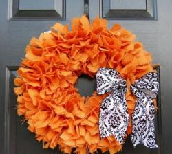 Orange floral Halloween wreath with white and black bow.JPG