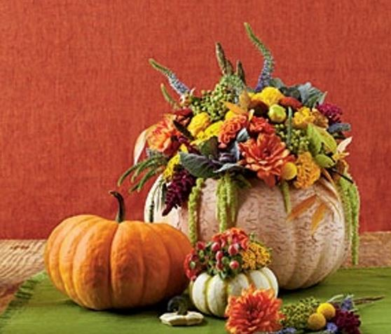 Fall centerpiece with Autumn flowers and pumpkin vases.JPG