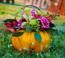 Pretty flower pumpkin basket with fresh flowers.JPG