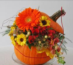 Beautiful pumpkin centerpiece with fresh colorful Autumn flowers.JPG