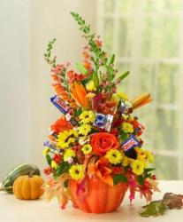 Beautiful Halloween pumpkin centerpiece with candy can be ordering online.JPG