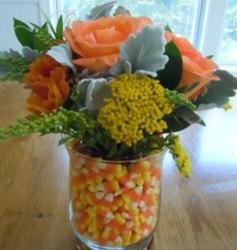 Chic Fall flower arrangement with candy corn.JPG