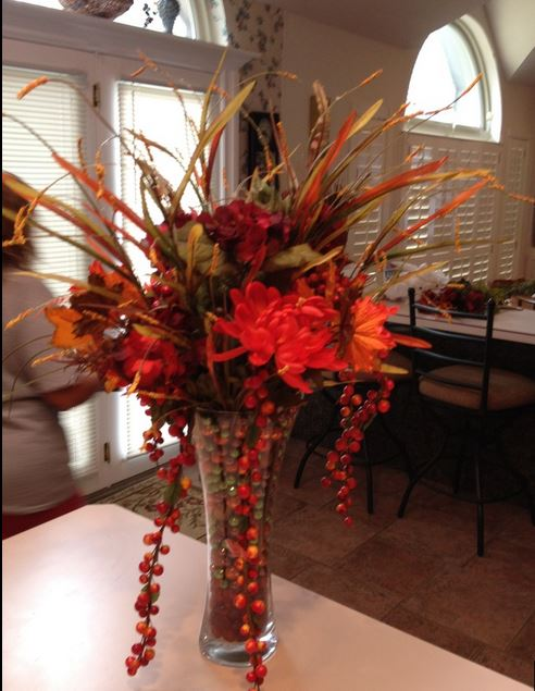 Fall arrangment with red flowers and berries.JPG