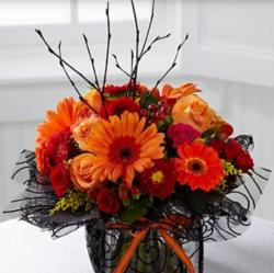 Fresh flowers centerpiece perfect for Hallowe.JPG